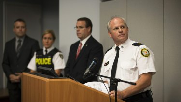 Toronto Police Services Superintendent Bryce Evans, right, speaks to the media regarding the investigation into the AshleyMadison.com breach.
