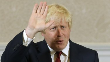 Former London mayor Boris Johnson waves after announcing he will not run for leadership.