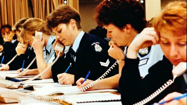Policewomen take calls during a special phone-in on sexual assault in 1993.