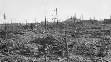 Stretcher bearers of the 57th Battalion, passing through the cemetery near the mound in Polygon Wood in the Ypres Sector.