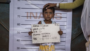 Three-year-old Anwarsah, a Rohingya child, poses for an identification photo at a temporary shelter in Aceh province, Indonesia, last year.
