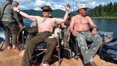 At ease: Putin laps up the sunshine.