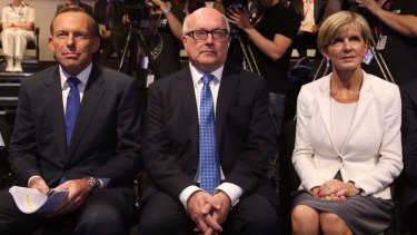 """Foreign Minister Julie Bishop, pictured with Tony Abbott and George Brandis, says the Prime Minister's comments linking tsunami aid to the clemency bid for the two Australians on death row in Bali was seen as """"unhelpful"""" by Indonesia."""
