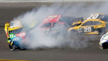 Erik Jones (77) and Matt Kenseth (20) collide with Kyle Busch (18).
