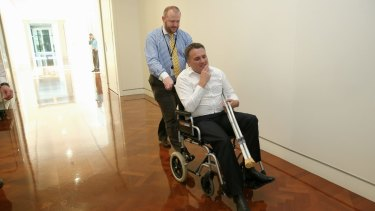 Mr Briggs, pictured the day after Tony Abbott lost the prime ministership, injured his knee at a party hosted by the former leader on the night he was dumped as PM.