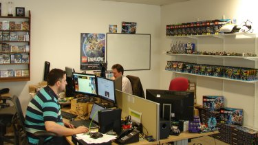 TT Games employees hard at work, surrounded by products from Lego Dimensions, TT's toys-to-life game.