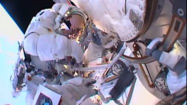 Tim Peake during on his first spacewalk after replacing a faulty voltage regulator on the International Space Station. This image comes from fellow spacewalker Tim Kopra's helmet-mounted camera.