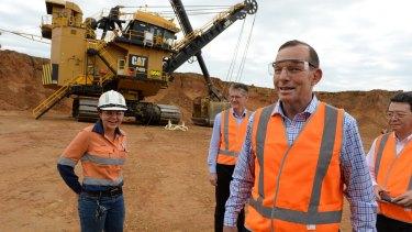 "Tony Abbott, at the Caval Ridge coal mine last year, said: ""Coal is essential for the prosperity of Australia."""