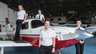 Women flying high: Pilot Tessa Beyersdorff with collegues Steph Barry, Amelia Andermahr and Kara Eggleston at Bankstown Airport's Sydney Flying School.