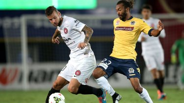Uncertain future: Central Coast's Isaka Cernak competes for the ball with Western Sydney's Nicholas Kalmar last month.