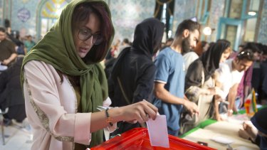 Iranians began voting Friday in the country's first presidential election since its nuclear deal with world powers.