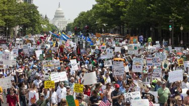 Demonstrators march down Pennsylvania Avenue during the People's Climate Movement March in Washington on Saturday.