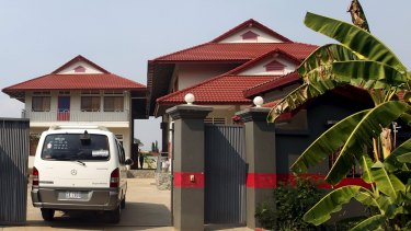 A van enters a residence temporarily housing the first group of asylum seekers in Phnom Penh, Cambodia in June.