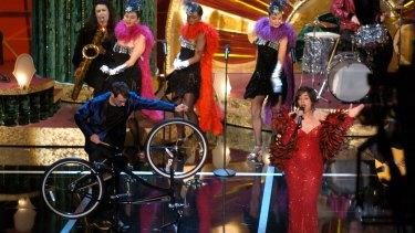 Benoit Charest, left, performed <i>Belleville Rendez-vous</i> at the 2004 Academy Awards.