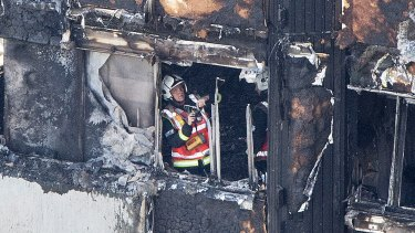 A fireman checks the damage to the building, which was largely charred in the fire.