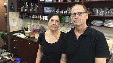 """""""They're taking away our livelihood'': Deanne and Spiro Coucouvinis at their cafe they have run since 2003."""