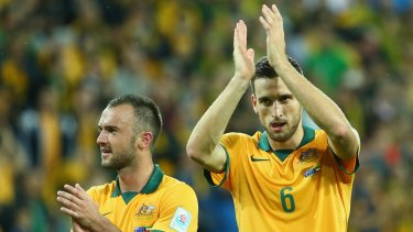 Matthew Spiranovic (right) expects Australia's defence to be much better in the game against Oman on Tuesday.