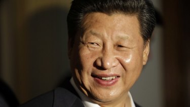 Chinese President Xi Jinping smiles as he concludes a visit to Lincoln High School in Tacoma, Washington, during his US visit.
