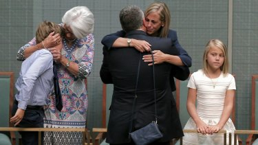 Joe Hockey embraces by his wife Melissa Babbage after his final speech to Parliament in October.