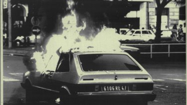 A French licensed car burns in the street after it was set ablaze in San Sebastian in 1987. Police believed it to be the work of ETA.