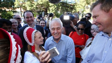 Prime Minister Malcolm Turnbull met Russian school dancers during a street walk in Homebush on Saturday with local MP Craig Laundy, right.