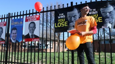 A GetUp supporter hands out how-to-vote in the ACT in 2013.
