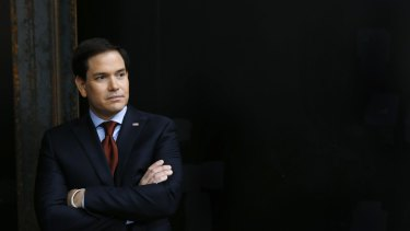 Marco Rubio waits to speak at a caucus site in Clive, Iowa, on Monday.