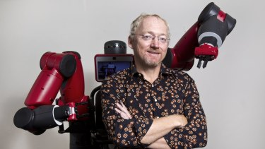 UNSW Professor Toby Walsh with a much friendlier, industrial robot called Baxter. The professor was a major driving force behind the open letter calling for a ban on killer robots.