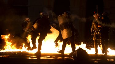 Riot police try to avoid petrol bombs thrown by anti-austerity protesters in Athens on Wednesday.