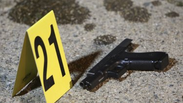 A gun sits by a marker following a shooting on Friday in Philadelphia.