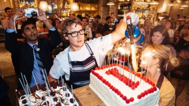 Chef Christopher Hogarth lights Papi Chulo's birthday cakes.