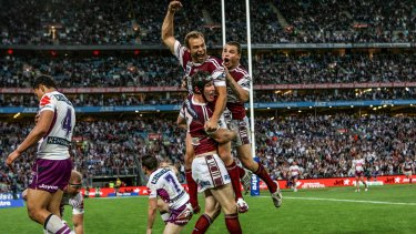 Stewart celebrates Manly's 2008 grand final win over the Melbourne Storm with teammates.