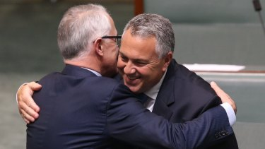 Prime Minister Turnbull embraces Treasurer Joe Hockey after his valedictory speech.