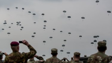 Soldiers watch on US, UK and Italian paratroopers take part in a training exercise in Germany.