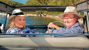 Lyndey Milan and Ian 'Herbie' Hemphill in their beloved 1961 EK Holden named Edna, in <i>Lyndey and Herbie's Moveable Feast</i>.