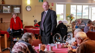 Kalyna Care CEO Darren Leech with residents eating lunch at the former Ukrainian aged care home