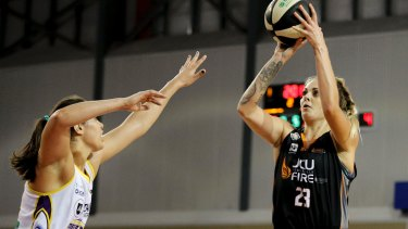 Townsville Fire's Carla George lines up a shot.