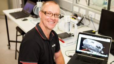 Griffith University PhD candidate Chris Little with his 3D modelling of captured German tank, Mephisto.