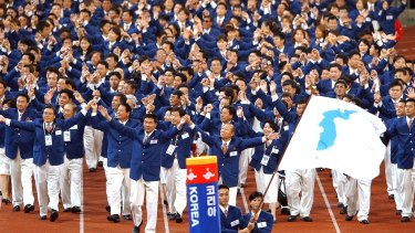 Athletes from North and South Korea march together, under a unification flag at the 14th Asian Games in Busan, South Korea in 2002.