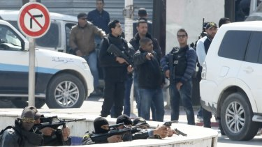 Police officers outside Parliament in Tunis.