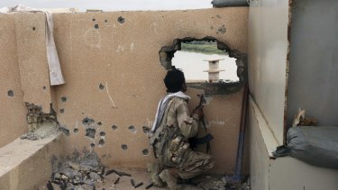 An Iraqi soldier guards a checkpoint in Tikrit.