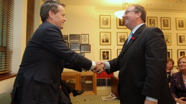 Opposition Leader Bill Shorten congratulates David Feeney after he joined the Labor Party caucus in 2013.
