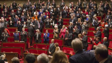 International pressure: French MPs applaud after a vote in favour of the recognition of a Palestinian state on Tuesday.
