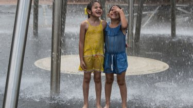 Children sought relief under a fountain in the hot conditions.