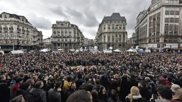 People observe a minute of silence at the Place de la Bourse in the centre of Brussels on Wednesday.