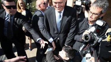 Chas Licciardello falls at the feet of Mr Turnbull.