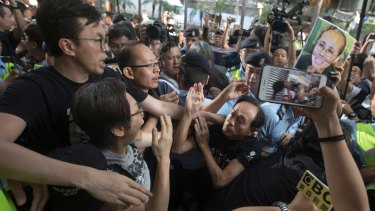 Pro-democracy protesters clash with pro-China counter-protesters blocking their march to the venue where official ceremonies were held to mark the 20th anniversary of Chinese rule over Hong Kong in Hong Kong on Saturday