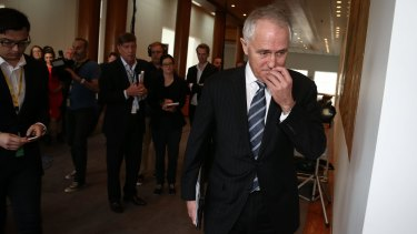 Communications Minister Malcolm Turnbull after speaking to the media.