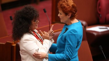 Labor senator Malarndirri McCarthy with senator Pauline Hanson after the One Nation leader's first speech in the Senate.