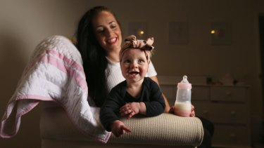 Tara Lloyd feeds her 8-month-old daughter Gracie Perkin a2 Platinum infant formula.